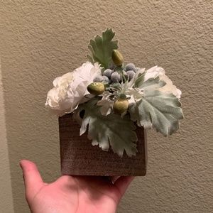 Floral arrangement in wood plant box